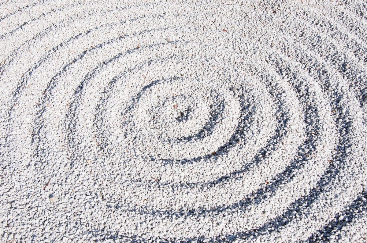 Concentric circles in sand.